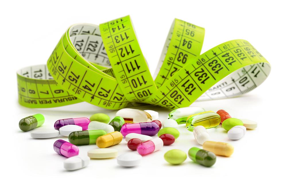 зелёный метр и витамин в таблетках